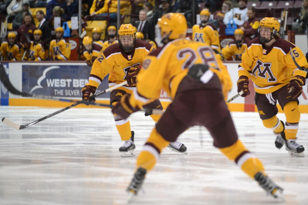 Sophomore forward Tyler Sheehy skates down the ice at Mariucci Arena on Feb. 4, 2017.