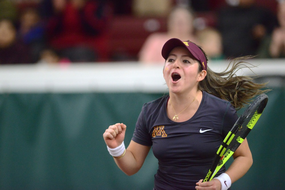 Sophomore Camila Vargas Gomez cheers at Baseline Tennis Center on Saturday, Mar. 4, 2017. The Gophers played against the University of Wisconsin.