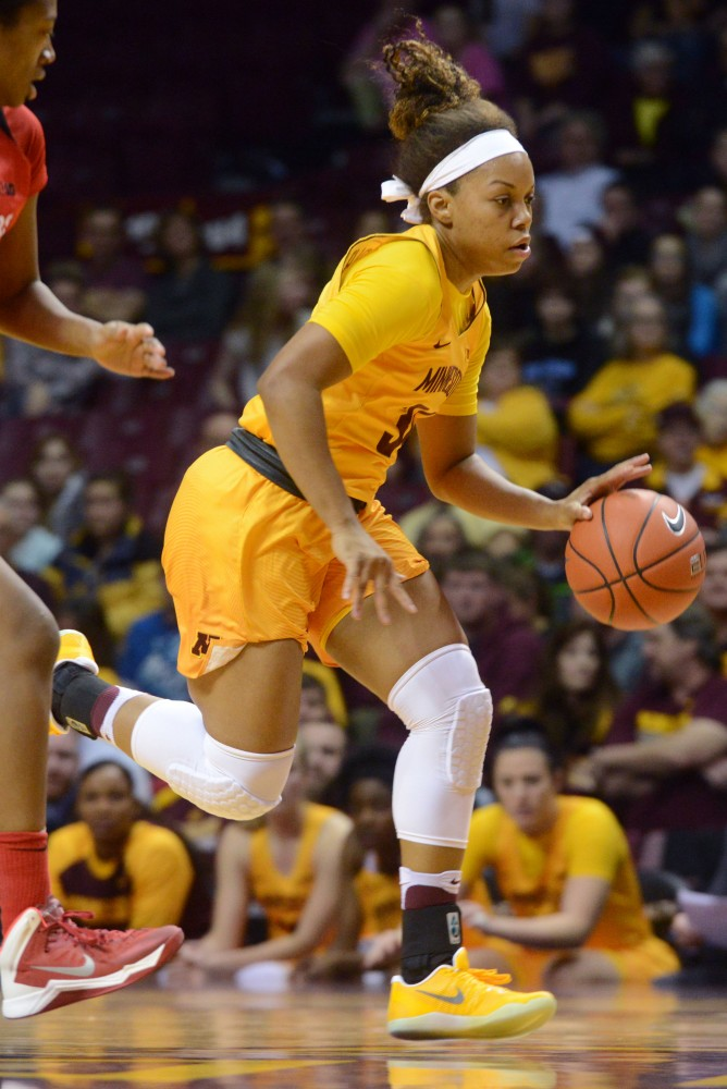 Freshman Guard Gadiva Hubbard drives the ball up the court on Saturday Feb. 11, 2017 at Williams Arena.