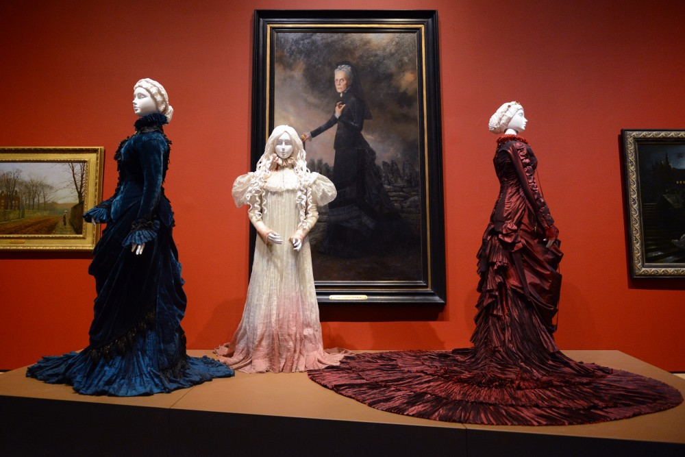 Costumes from the movie Crimson Peak sit ondisplay at Guillermo del Toros At Home With Monsters exhibit at the Minneapolis Institute of Arts on March 2, 2017.