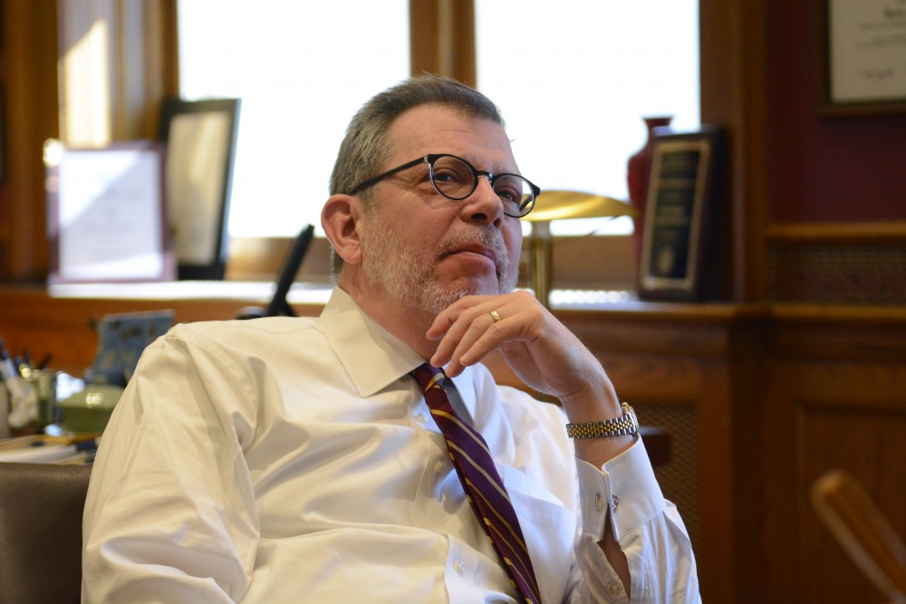 University President Eric Kaler thinks about what his favorite movie is in Morrill Hall on Wednesday, March 8.