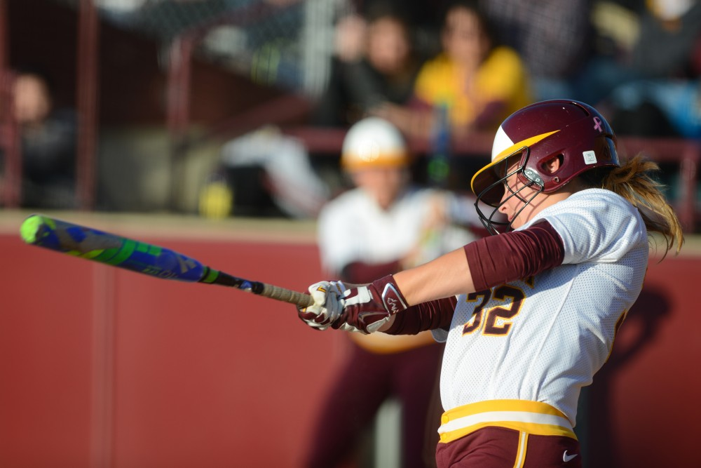 Junior infielder Sydney Dwyer swings at a pitch at Jane Sage Cowles Stadium on Friday, Apr. 23, 2015.