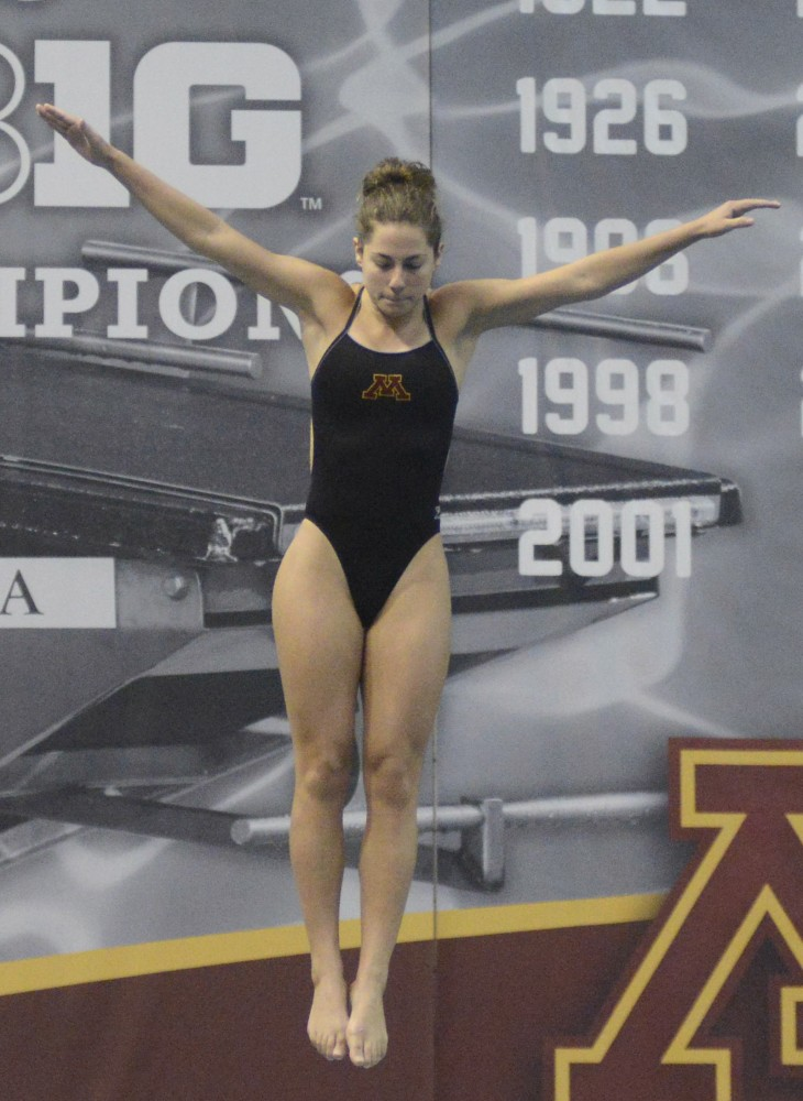 Senior Lexi Tenenbaum competes in women's 3-meter dive at the Jean K. Freeman Aquatic Center on Saturday, Feb. 4, 2017 in Minneapolis.