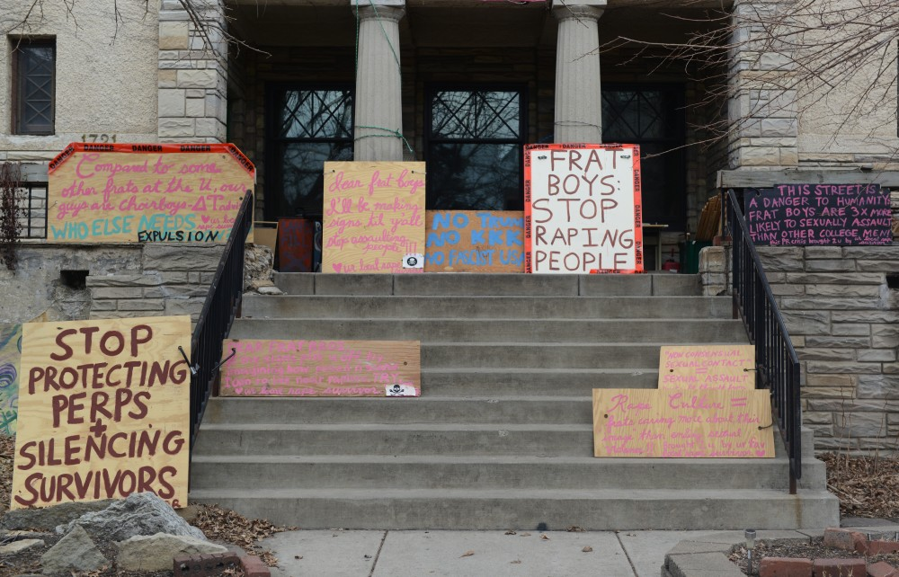 Hand painted signs sit in-front of the Students' Co-Op on Monday, March 20, 2017. Members of the greek community are frustrated with the tone and content of the signs.