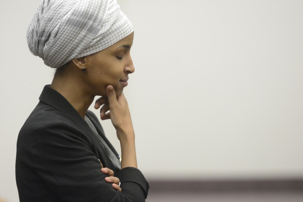 Rep. Ilhan Omar, DFL-Minneapolis, listens to an attendee's questions on Friday, Mar. 24 at Mondale Hall on West Bank.