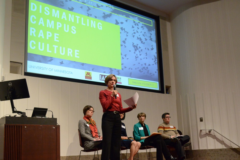 Susan Craddock opens the Dismantling Campus Rape Culture Panel at Mayo Memorial Auditorium on Saturday, Mar, 25. 2017.