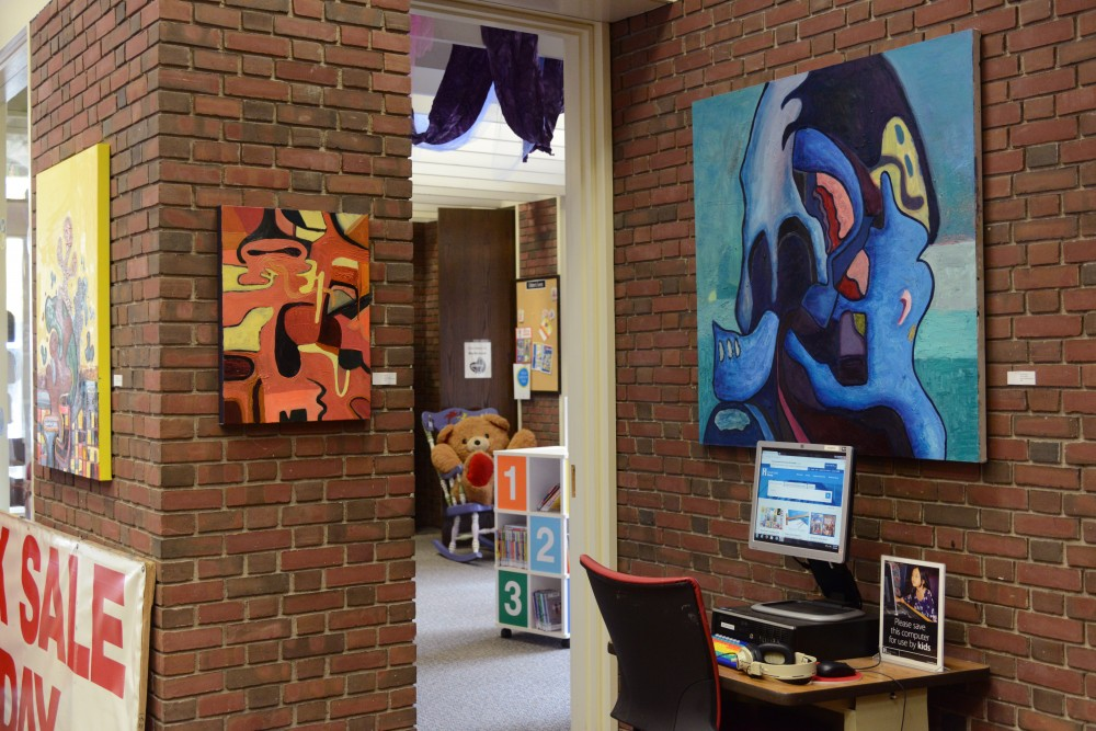 Paintings by Noah Czarnecki-Freeman's in his Jelly Heads exhibit at Southeast Library in Minneapolis on Saturday, Mar, 25. 2017.