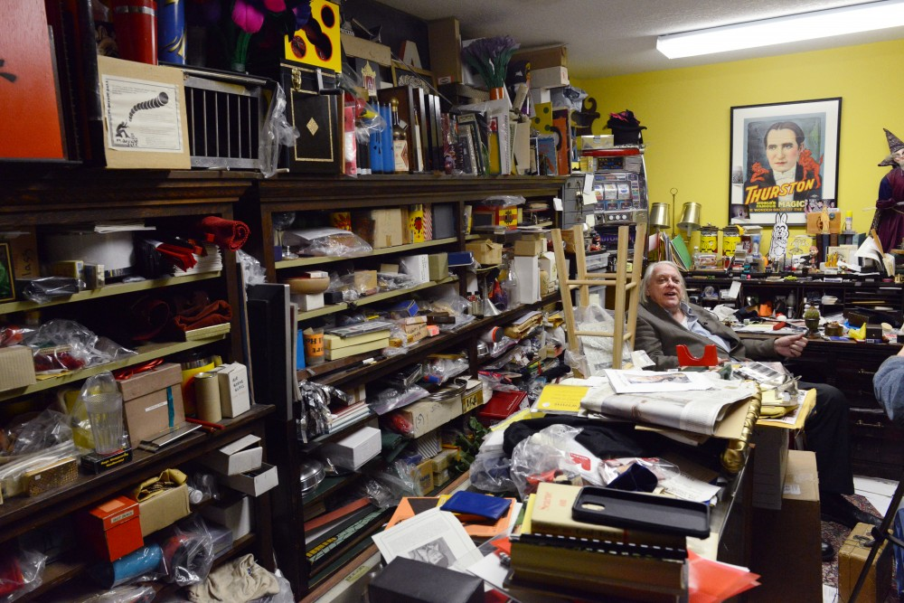 Shop owner Larry Kahlow sits at his desk in Eagle Magic and Joke Store on Friday, March 24, 2017.