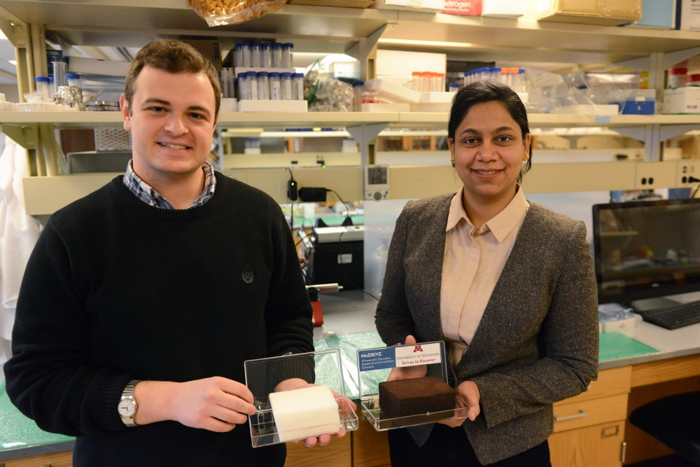 Department of Bioproducts and Biosystems Engineering graduate students John Brockgreitens and Snober Ahmed pose with the super sponge in the Kaufert Laboratory on Thursday, March 23, 2017. Nanoparticles grown on the sponge absorbs mercury in contaminated water within seconds.