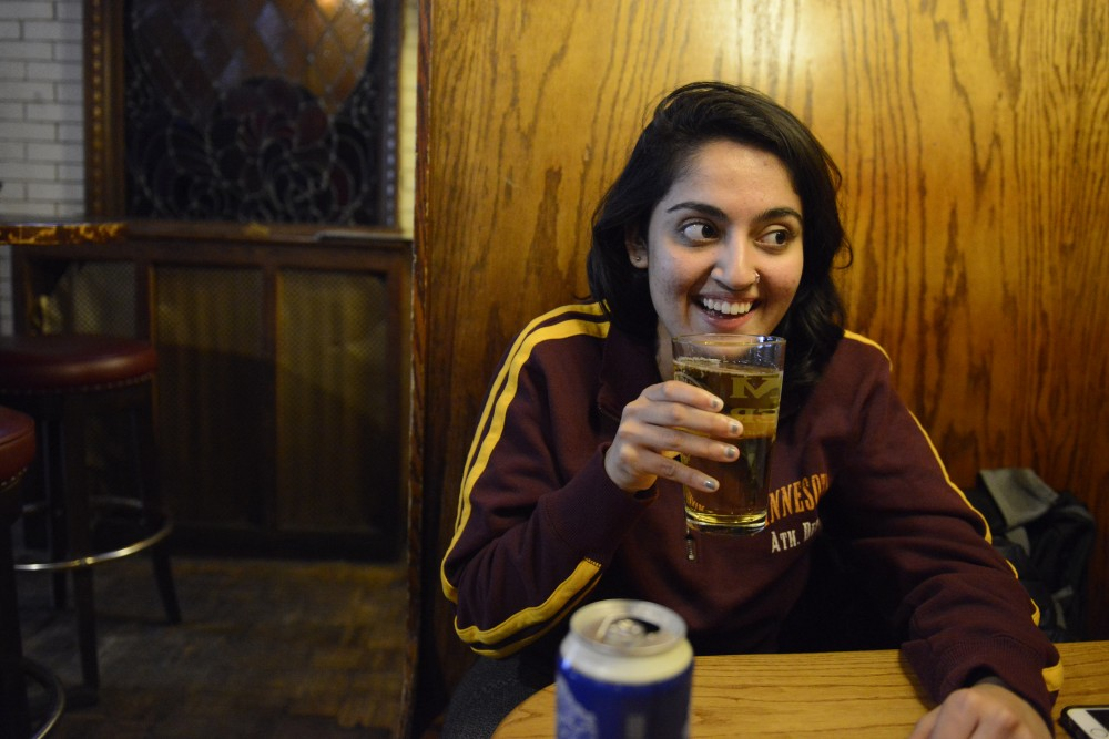 Student body president, Abeer Syedah, talks during a beer with Abeer at Stub and Herb's on Friday March 24, 2017 in Minneapolis