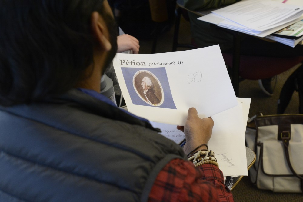 French junior Hemant Persaud holds a card with his character during the