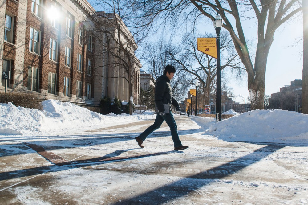 A lone student treks across the pedestrian mall in subzero temperatures while school was closed Jan. 27.