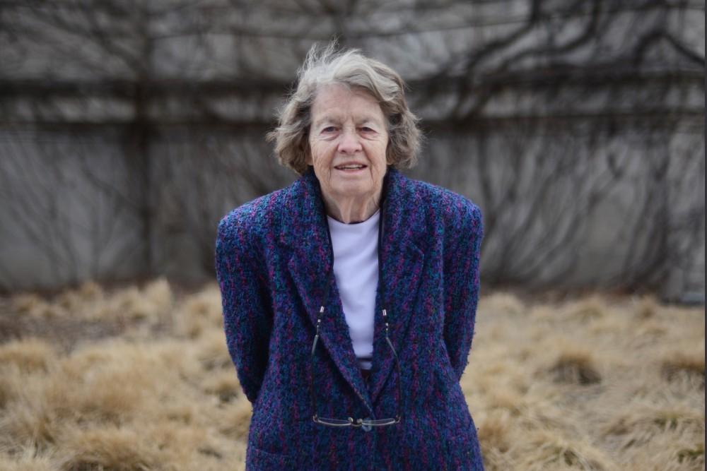 Ann Pflaum, the University's historian, poses for a portrait outside Northrop Auditorium on Wednesday, Mar. 22, 2017.