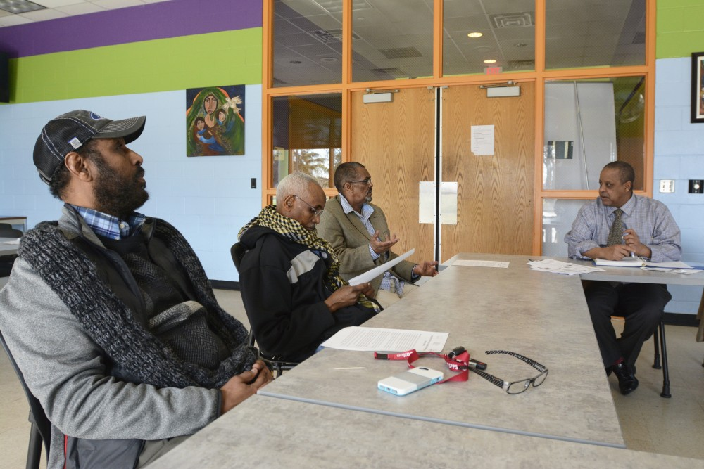 Bashar Mohamed, Mohamed Ahmed and Abdi M Dagal listen to a healthcare program led by Abdullahi Sheikh that educates immigrant and refugee seniors in the Brian Coyle Center on Friday, Mar. 31, 2017.