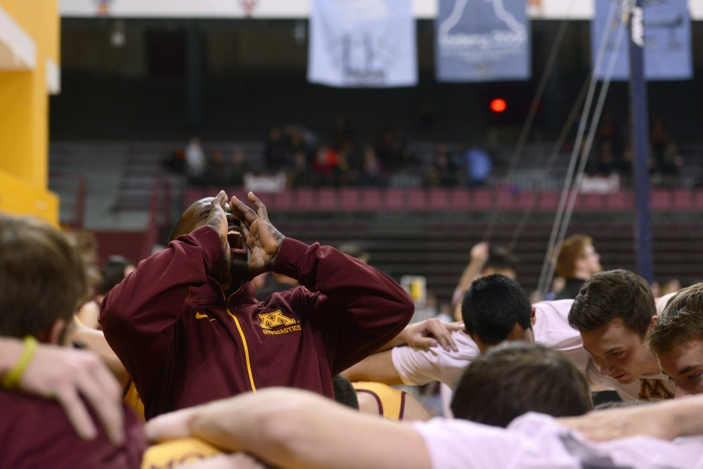 Jalon Stephens yells a chant in between events Saturday at the Sports Pavilion. The Gophers scored the fourth highest team score in program history, defeating Nebraska  435.150-428.100.