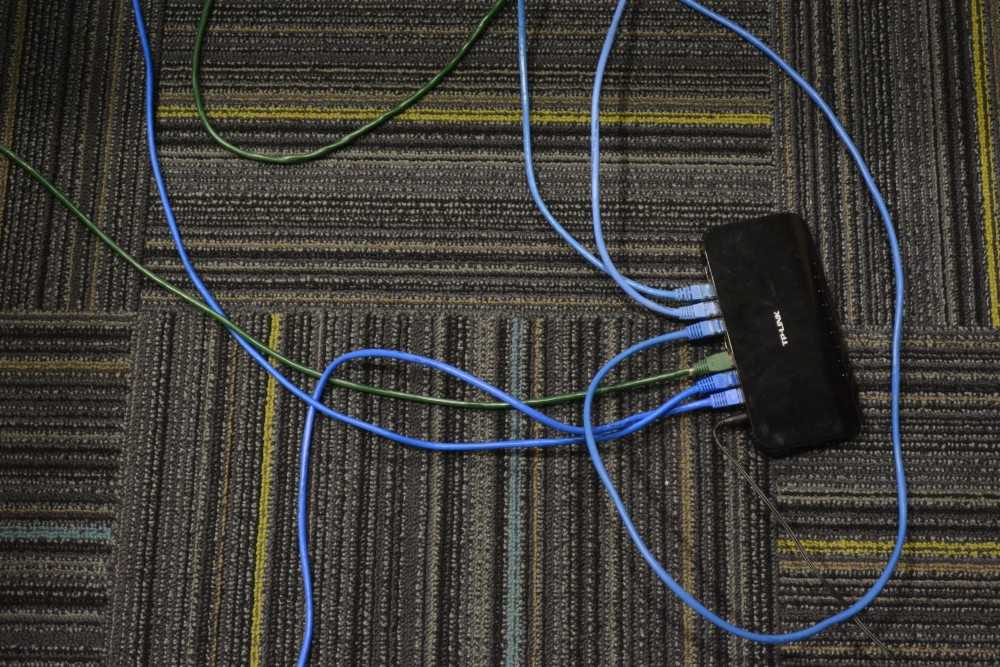 A internet modem lays on the floor during the University of Minnesota's League of Legends team's first practice on Saturday, April 1, 2017 at Argyle House. The team says it's hard to play at the highest level while managing themselves without support from the University.