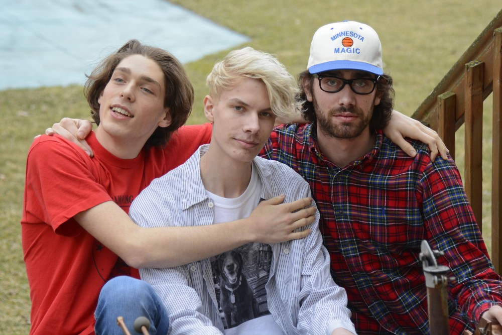 Members of Remo Drive, Erik Paulson, Stephen Paulson and Sam Mathys, pose for a portrait in the backyard of their practice space on Thursday, March 30, 2017 in Bloomington. The indie rock band recently came out with a new album,
