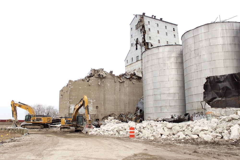 Demolition of the Electric Steel grain elevators continues on the edge of the East Bank campus on April 8, 2017.