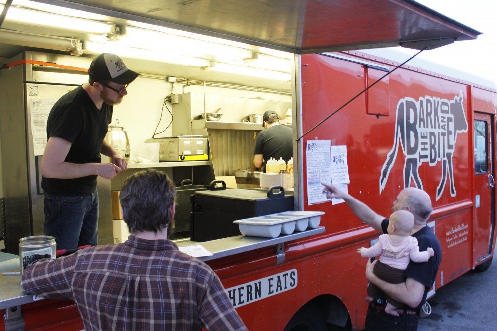 Nathan Nasuta help a customer at The Bark and Bite food truck at Bent Brewstillery in Roseville on Saturday, Apr, 8. 2017.
