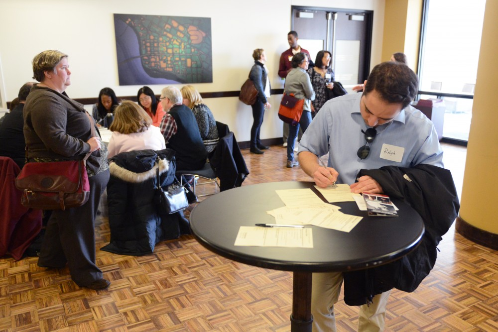 Staff member Ralph Blanco fills out a feedback form at the University Community Conversation in Coffman Memorial Union on Tuesday, April 11, 2017. Blanco said he's interested in the Immigration Response Team's vision and goals.