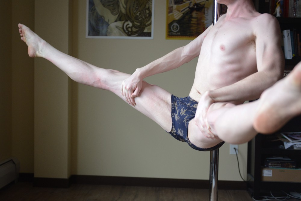 Eric practices pole dancing in his apartment on Sunday, April 9, 2017. Eric pole dances for fun and athletic purposes, occasionally freelancing at the Gay 90's, while pursuing his college education at the University of Minnesota.