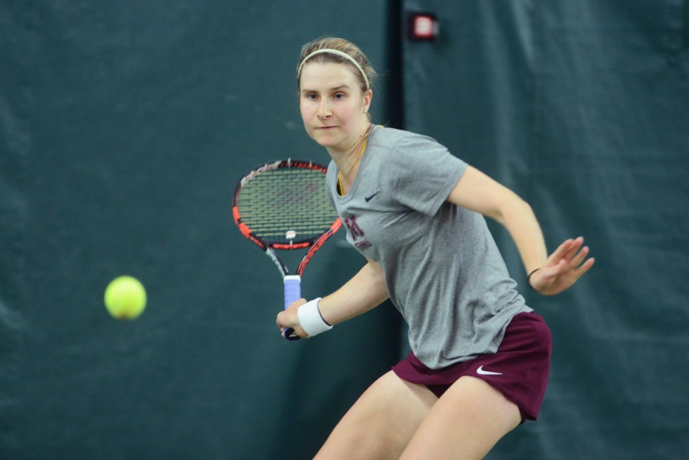 Junior Caroline Ryba returns the ball during a match against Ohio State on Friday, April 14, 2017.