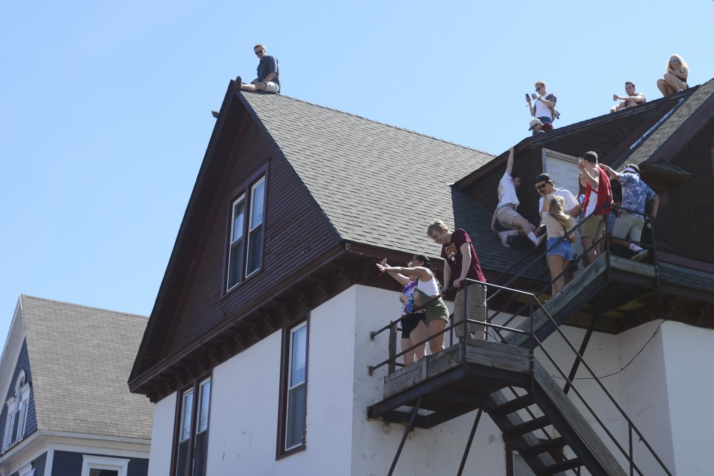 A group parties on the roof of a house in Dinkytown at the Sssdude-Fest Block Party on Saturday, April 22, 2017.