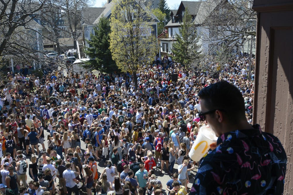 Kinesiology senior Jared Antilla watches over the crowd from a balcony at the Sssdude-Fest Block Party on Saturday, April 22, 2017.