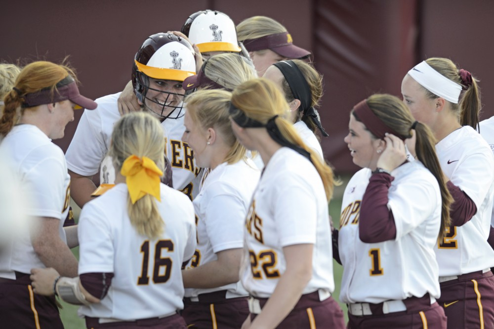 The Gophers congratulate Freshman catcher Kendyl Lindaman after she hits a home run on Friday, April 21, 2017 at Jane Sage Cowles Stadium. The Gophers won 5-0 against the Iowa Hawkeyes.
