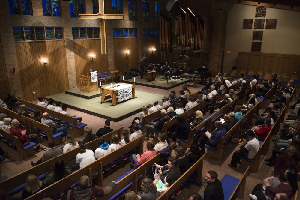 A prayer vigil is held for Chris Stanley at Oak Grove Lutheran Church on Wednesday, April 26, 2017.