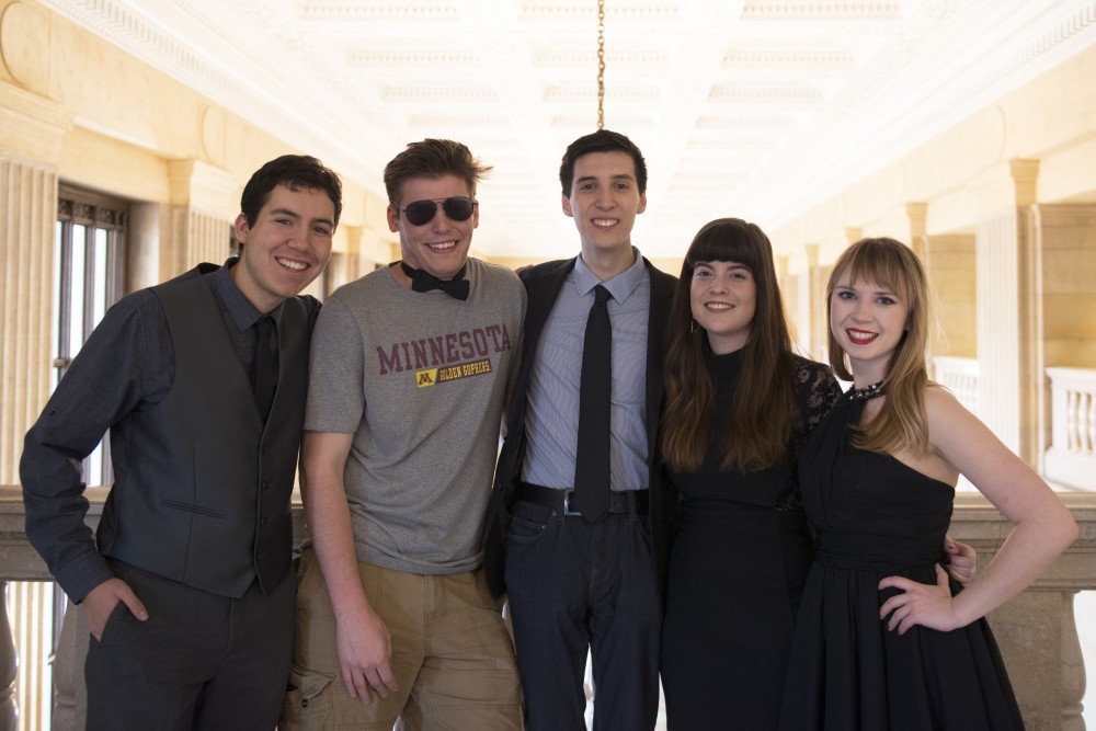 Minnecinema club members Andrew Schmidt, left, Kevin Olson, Sebastian Swanson, Eden Palmer, KC Schomas, right, pose for a portrait together in Northrop Memorial Auditorium on Friday, April 21, 2017.