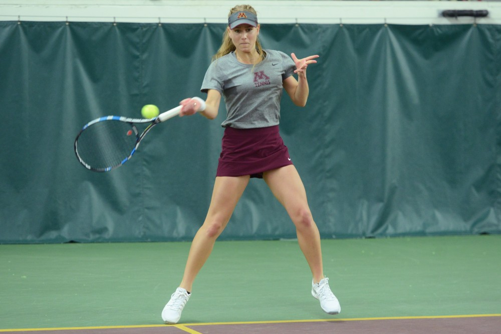 Freshman Tina Kreinis returns the ball during the match against Ohio State on Friday, April 14, 2017.