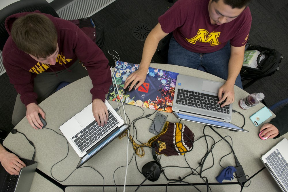 Computer science sophomores Calvin Greve, left, and James Han, right, play Dota 2 on Wednesday, Oct. 26, 2016 at Bruininks Hall on East Bank during the uDota club's weekly meeting.
