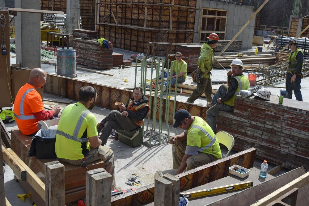 Construction workers eat lunch on the corner of Washington Avenue and Church Street.