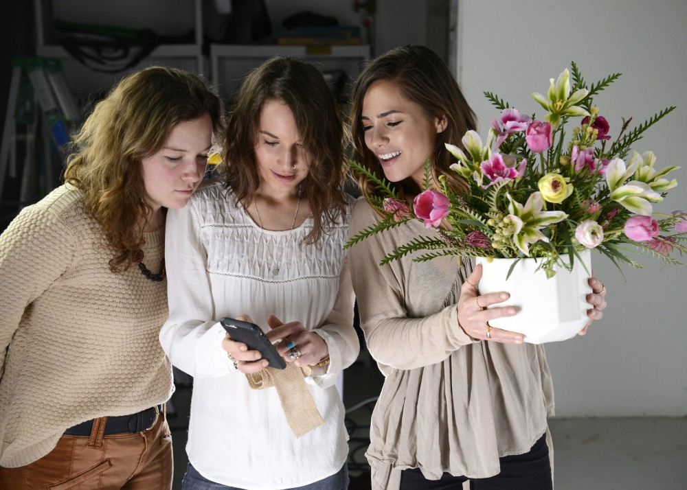 Left to right, local florist Tamara Rose Dee and fashion bloggers Haley Brumley and Sami Huerta review photos taken on an iPhone in the Treefort Studio in St. Louis Park on Thursday, March 10.