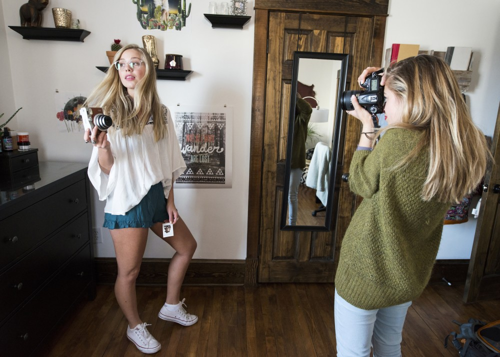 University of Minnesota student and local photographer Kailey Erdahl photographs fashion blogger Courtney Steeves in her home on Monday, April 4.