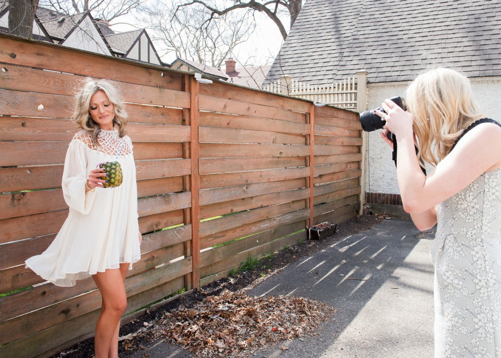 Minneapolis photographer Kate Becker photographs fashion blogger Tamara Waterston behind her home in South Minneapolis on Saturday, April 16.