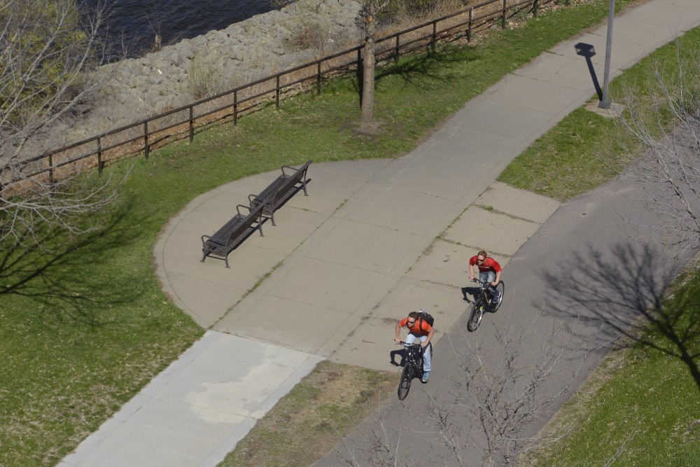 Cyclists ride on West River Parkway on Saturday, April 22, 2017.