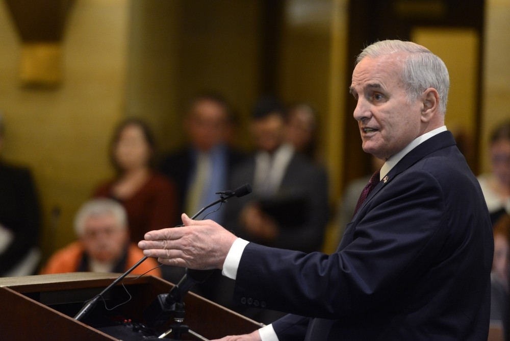 Gov. Mark Dayton answers questions during a press conference about Minnesota's budget at the Capitol in St. Paul in February.