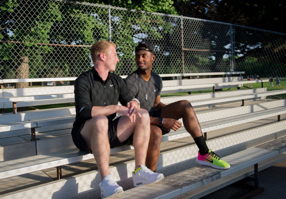 Brad Neumann, left, and Justin Rabon pose for a photo at Van Cleve Park on Friday, June 9. 2017. The sprinters came out to each other through a text message, and are happily together two and a half years later.