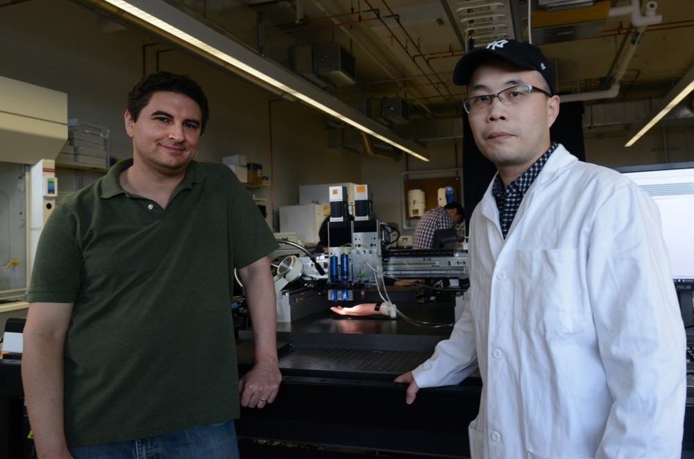 Michael McAlpine and ShuangZhuang Guo pose for a portrait in the Mechanical Engineering building on May 23, 2017. McAlpine and his lab, including Guo, the lead researcher on the project, created a method of 3D printing that could allow for printing on human skin.