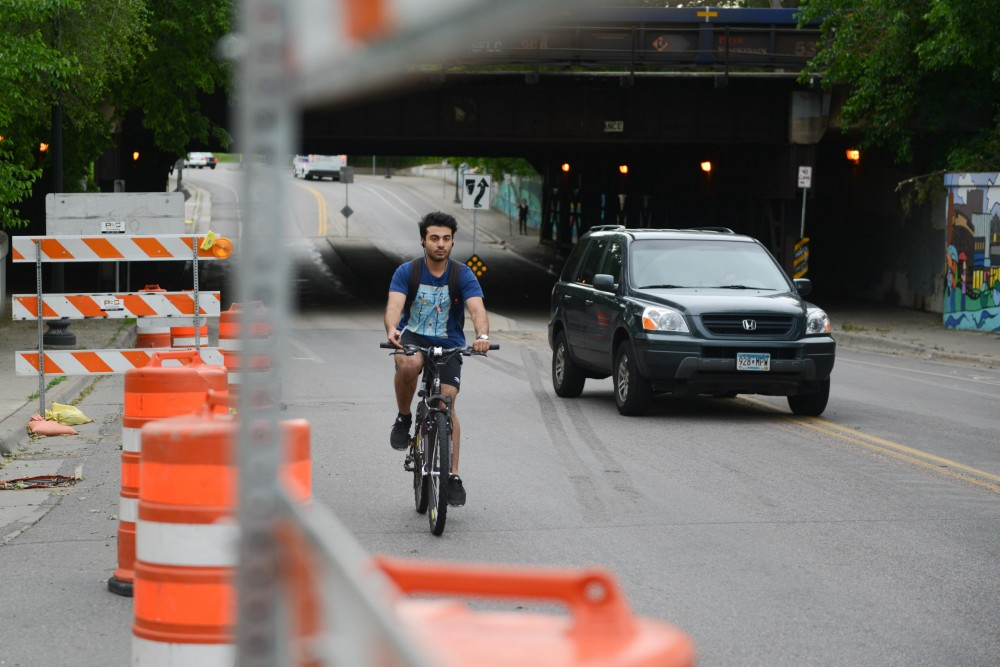8th Street SE is partially closed for construction on Monday, June 12, 2017. The University's Center for Transportation Studies is working on a new app that uses Bluetooth to alert drivers about nearby construction and bikers.