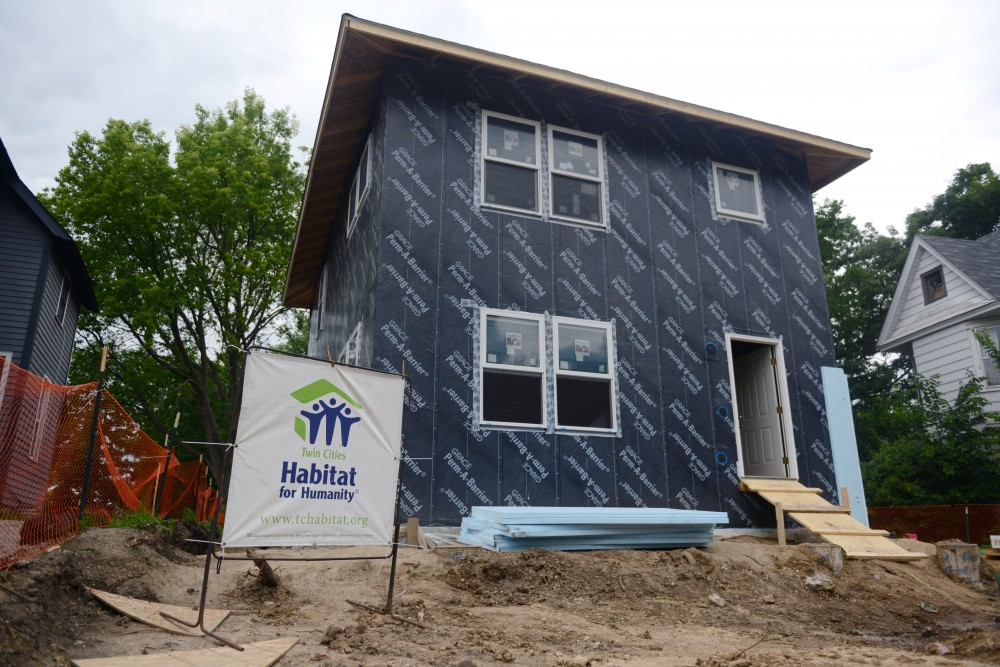 A Minneapolis grant from the U.S. Dept. of Energy is letting the city build MonoPath housing for energy efficient and affordable houses in low income neighborhoods. The energy efficient building technique started at the University of Minnesota in the early 2000s and is now being put back to use after its development was delayed by the 2008 recession. Volunteers are seen working on a Northeast Minneapolis house on Monday, June 19, 2017.