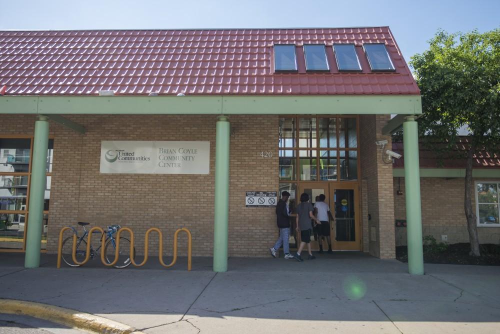 Kids enter the Brian Coyle community center on Thursday June 15, 2017.