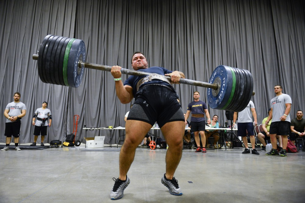 Justin Tweeton competes in a show of strength strongman competition at the Minneapolis Convention center on Saturday June 10. 2017.