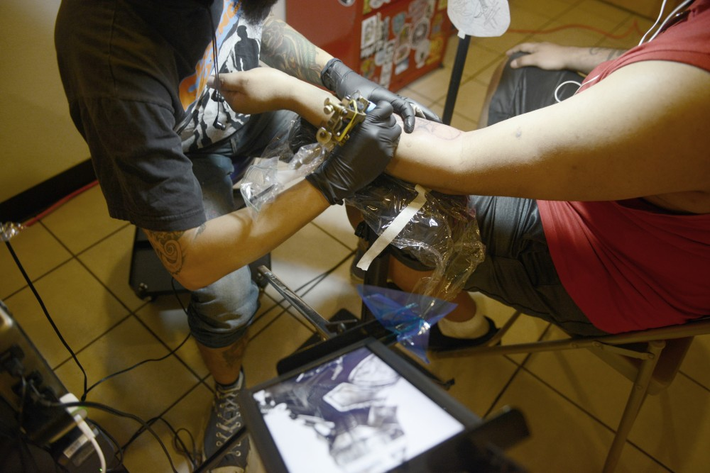 Marcus Thompson works on a Star Wars tattoo at Dinkytown Tattoo on June 3, 2017.