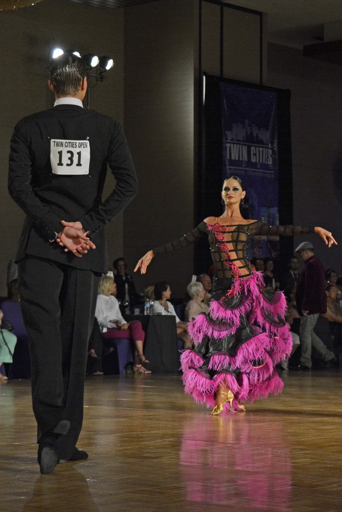 Anna Krasnoshapka performs during the professional open rhythm championship semi-final round at the Twin Cities Open Ballroom Championships at the Hyatt Regency in downtown Minneapolis on July 8, 2017. The competition hosted dancers from across the nation.