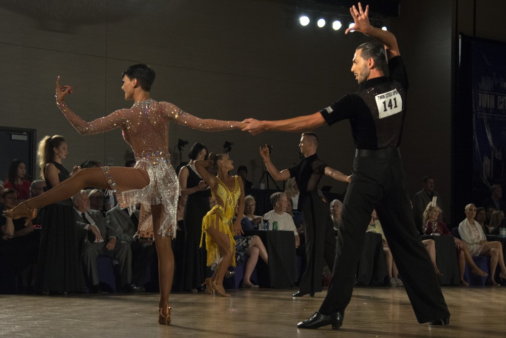 Viktoria Nemeth and Emanuele Magnasco perform during the professional open Latin championship semi-final round at the Twin Cities Open Ballroom Championships at the Hyatt Regency in downtown Minneapolis on July 8, 2017. The competition hosted dancers from across the nation.