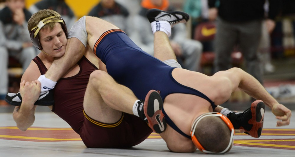Senior Logan Storley wrestles against Illinois at the Sports Pavilion on Jan. 18.