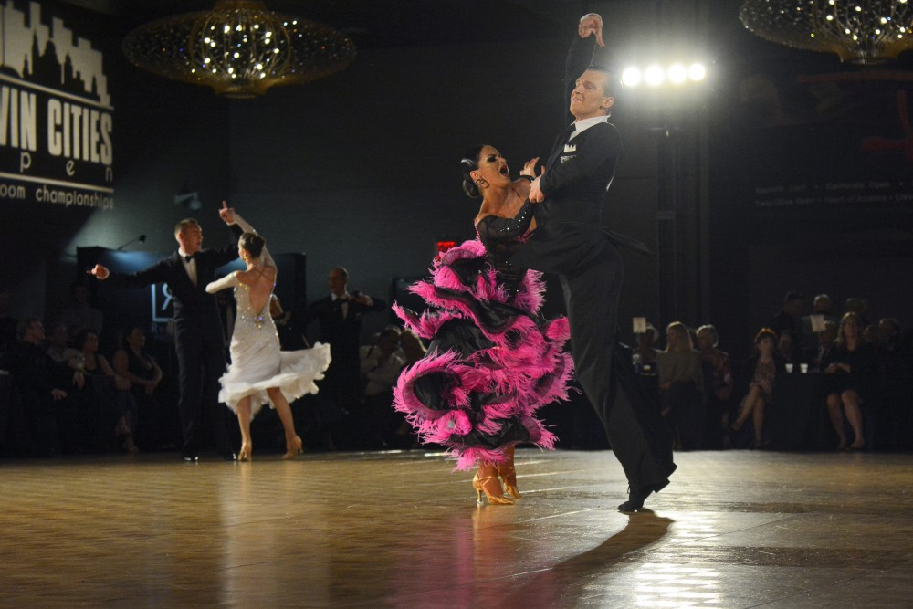 Anna Krasnoshapka and Mykyta Serdyuk perform at the Professional Open Rhythm Championship semi-final at the Twin Cities Open Ballroom Championships in downtown Minneapolis on July 8. The competition hosted dancers from across the nation.
